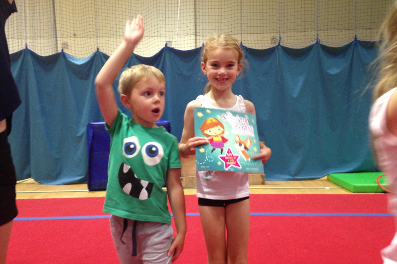 A brother and sister at their gymnastics club