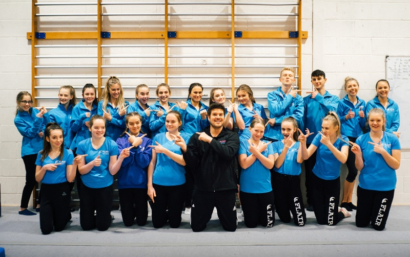 Richard Dwyer and the Flair Gymnastics coaching team