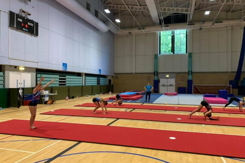 Practising lines safely distanced at a gymnastics club in Surrey