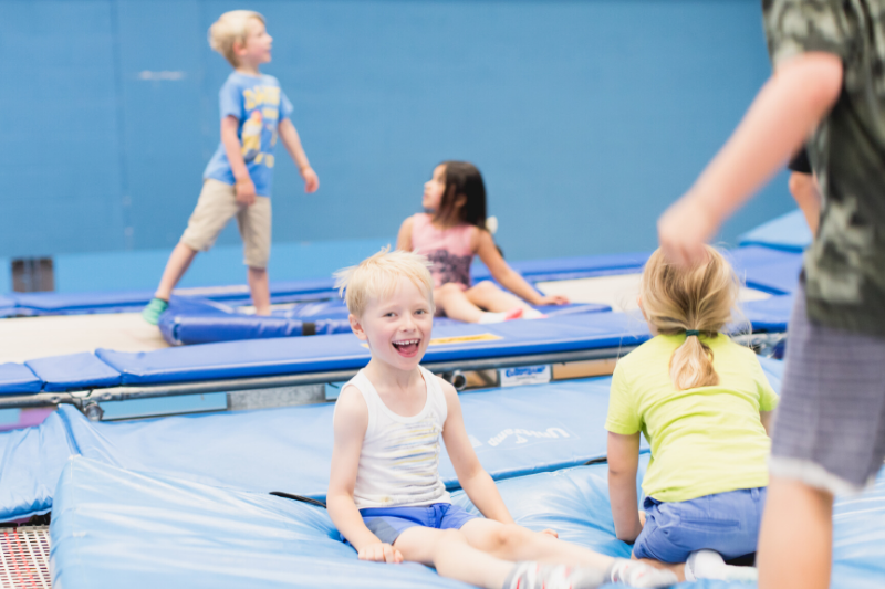 Happy children on a trampoline at their trampolining club