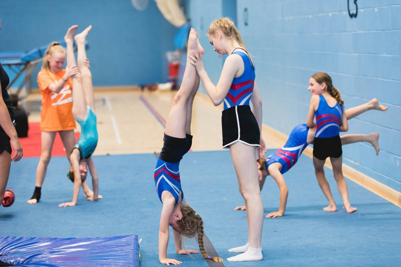 Children supporting each others handstands