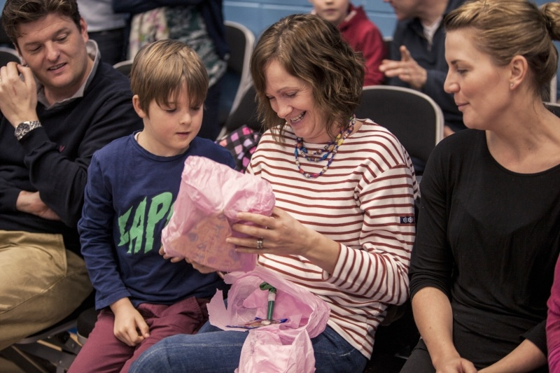 Get ready for a new start at your gymnastics club - family playing pass the parcel