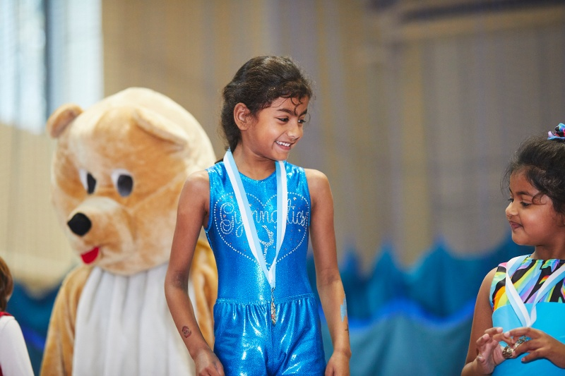 Child on podium with medal at gymnastics competition - why some parents got upset at the latest series of 'Child Genius'