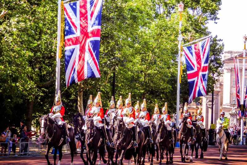 Soldiers on horses and union jack flags at Pall Mall