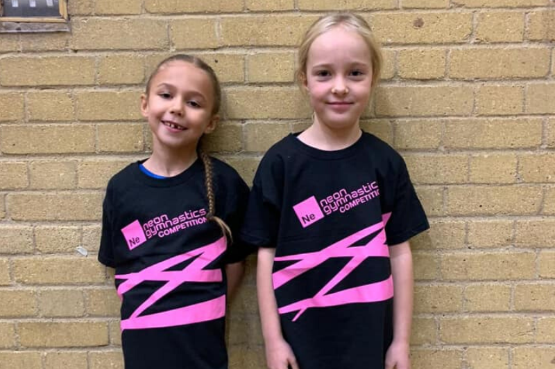 Two young display squad girls at the Neon competition