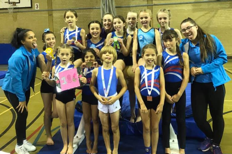 The display squad having fun at a gymnastics competition