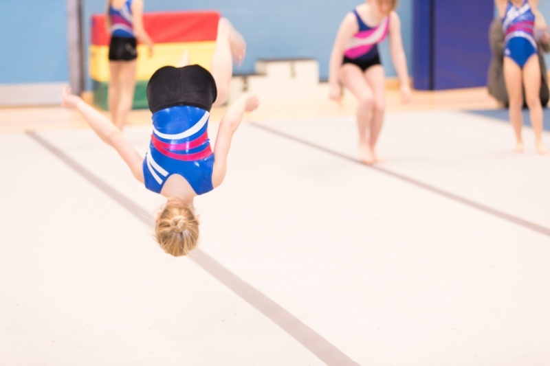 8 Reasons To Join The Display Squad - Child in gymnastics class mid somersault
