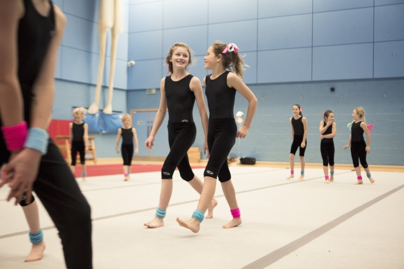 8 Reasons To Join The Display Squad - gymnastics class showing 2 girls walking side by side
