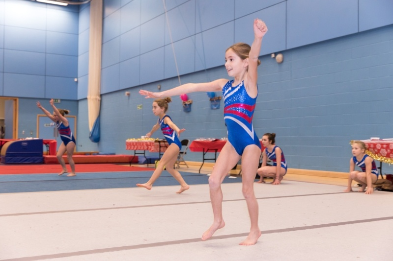 8 Reasons To Join The Display Squad - children half way through a gymnastics floor routine